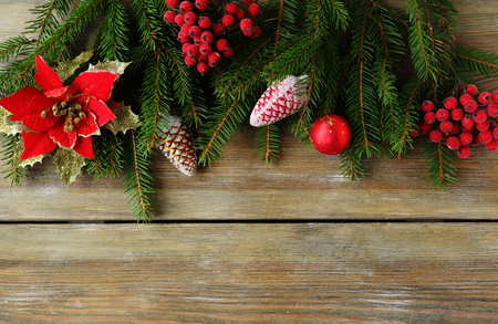 christmas backdrop: christmas backdrop with green branch and red decorations, top view Stock Photo