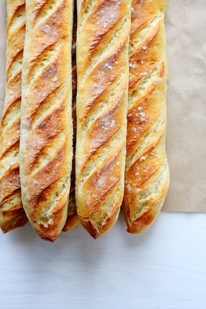 artisan bakery: fresh golden french breads, top view Stock Photo