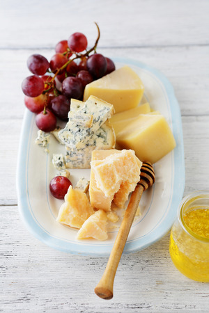 cheese platter: cheese platter with grapes, food close-up