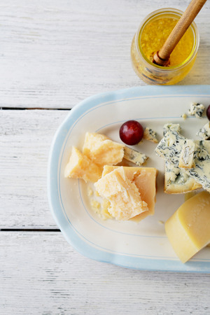plate: cheese on vintage plate Stock Photo