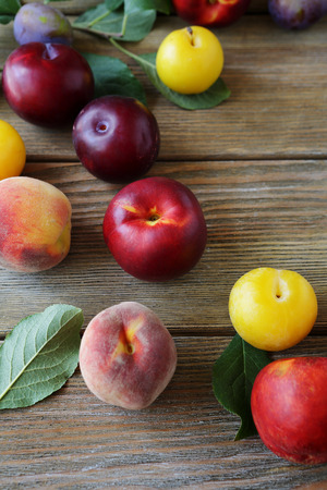 alycha: nectarines and peaches on wooden boards, fruits