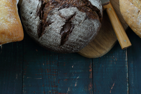 rustic food: loafs rustic bread on wooden boards, food Stock Photo