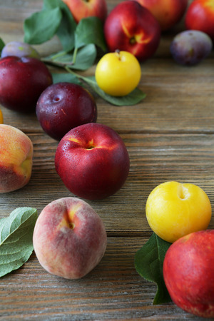 alycha: nectarines and peaches on wooden background Stock Photo