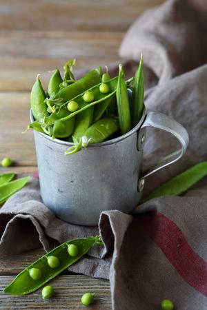 rustic food: fresh green peas on rustic table, food Stock Photo