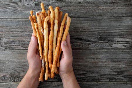 grissini: italian grissini in male hands, food