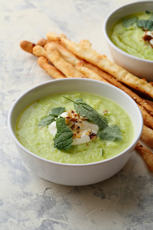 Bowls of zucchini cream soup, food close-up Banco de Imagens
