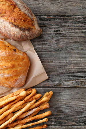 Fresh breads on wood background, food top view