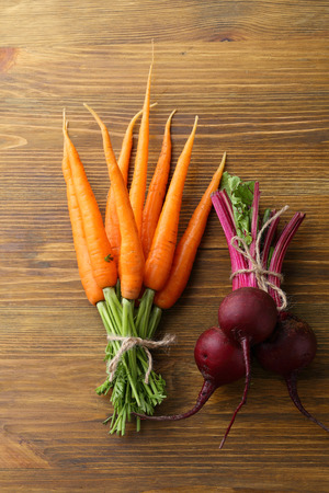 close uo: Bunches of carrots and beets, food close-uo