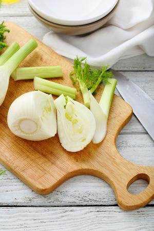 finocchio: Fresh fennel on cutting board, food closeup