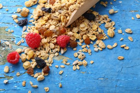 Fruits granola on rustic blue background, food closeup