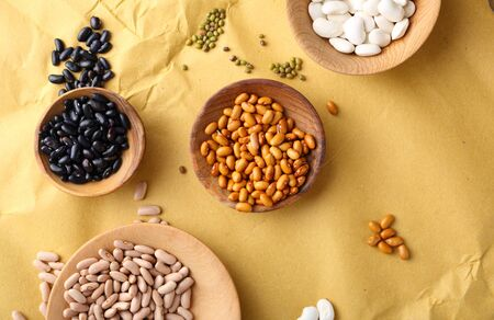 mung: Various of beans on paper, food top view Stock Photo