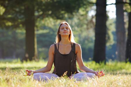 harmonizing: Girl meditating in park with harmonizing mudra