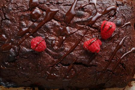 Homemade chocolate cake with raspberry and sauce, food top view