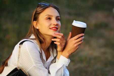 Young woman thougtful with coffee