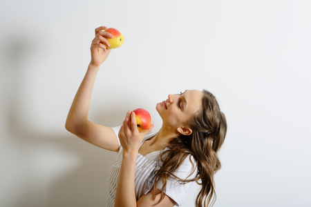 shef: Young woman holding ripe apples, healthy lifestyle Stock Photo