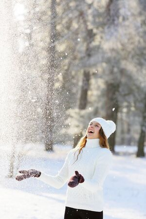 Laughing girl in a snow winter park outdoors Stock Photo