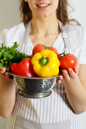 shef: Vegetables in a colander in the hands of the cook