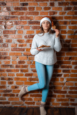 Young woman eating Christmas Gingerbread Cookies