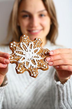 Cookie in woman hands, focus on cookies