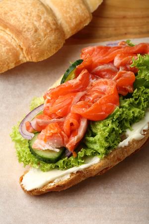 Croissant with salmon, food closeup Stock Photo