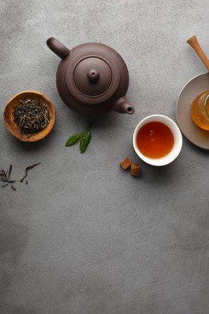 Tea setting on gray background, copy-space