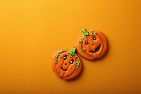 Two Halloween pumpkins, holiday food