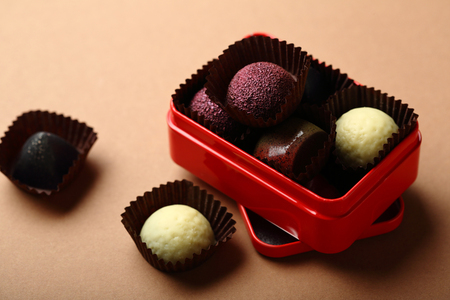 Truffle chocolate candies in red gift box, food closeup Reklamní fotografie