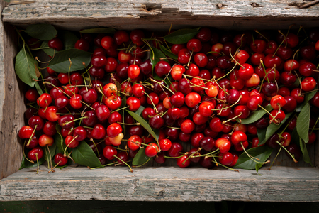 Fresh cherry in wooden crate above