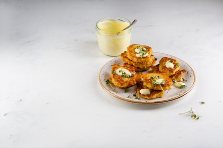 Cereal fritters on plate