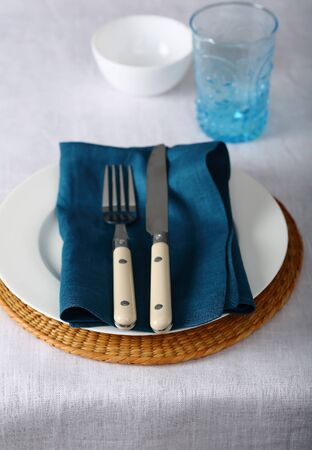 White linen cloth and blue napkin