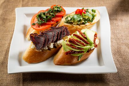 Set of toast with meat and vegetables Stock Photo