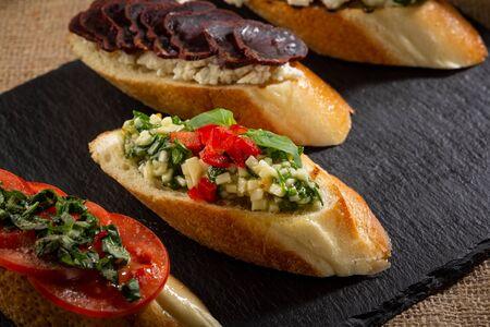 Italian bruschetta set on slate close-up Stock Photo