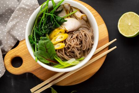 Healthy bowl with buckwheat noodles top view