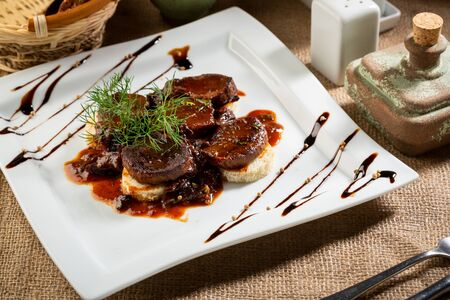 Braised meat  dish on white plate