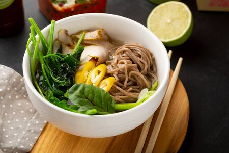 Bowl with buckwheat noodles and vegetables