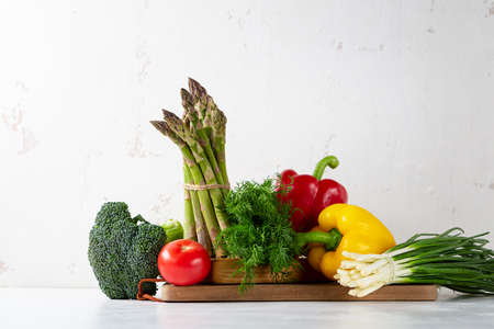 Still life with organic vegetables on white table Stock Photo