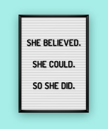 Motivation quote on white letterboard with black plastic letters. Hipster vintage inspirational poster 80x, 90x. She believed. She could. So she did.