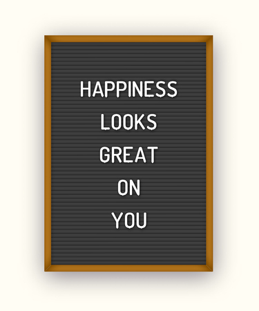 Motivation quote on black letterboard with white plastic letters. Hipster vintage inspirational poster 80x, 90x. Happiness looks great on you