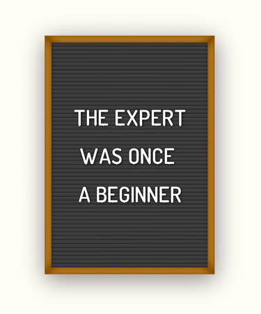 Motivation quote on black letterboard with white plastic letters. Hipster vintage inspirational poster 80x, 90x. The expert was once a beginner