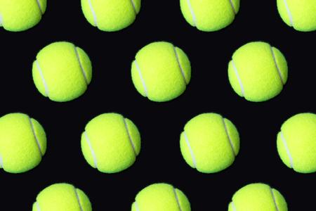 Pattern of tennis balls on black background Stock fotó