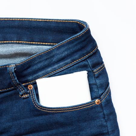 White feminine hygiene pad in a jeans pocket. Close up. Days of menstruation.