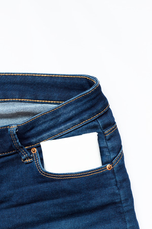 White feminine hygiene pad in a jeans pocket. Days of menstruation.