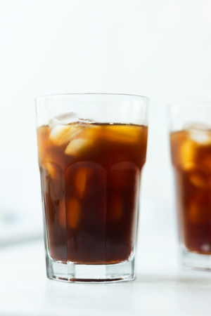 Cold brew. Coffee with ice on light background