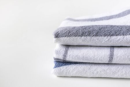 White kitchen towels folded with copy space, horizontal