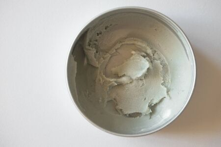Close-up texture of organic deodorant cream eco-friendly in metal container on white background