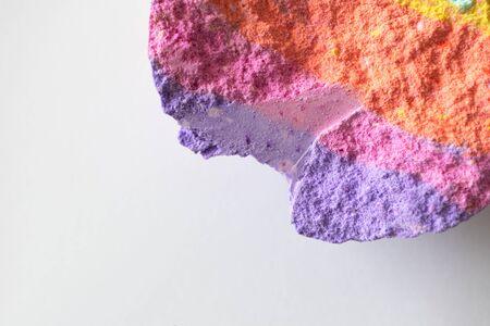 Halves rainbow bath bomb close-up on white background