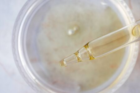 Liquid oil serum essence for face in dropper, closeup. Beauty skincare concept