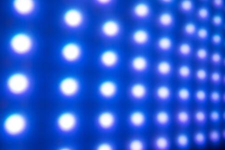 Defocused cold blue led light background. Illuminated pattern Stock Photo