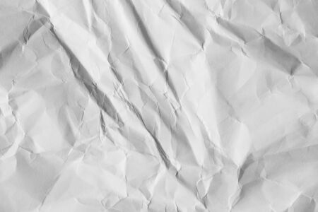 Crumpled white paper background. Wrinkled sheet texture, top view