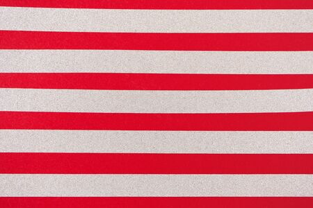 Silver glitter horizontal stripes on red background. Holiday pattern Banco de Imagens
